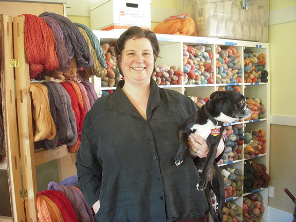 Maia with adopted Boston Terrier and her current selection of natural dyed yarn and roving.