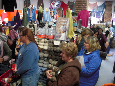 The Black Sheep Knitting Guild waits patiently to check out.